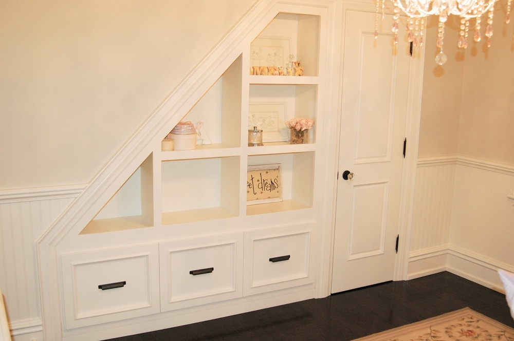 Cream Nursery with Built-in Bookcase & Storage